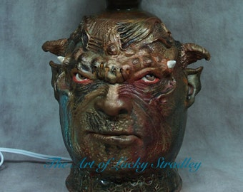 Face jug lamp, wheel thrown, hand altered and sculpted. Just a friendly little lamp to side beside you and light the darkness.