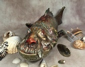 MUTANT FISH - hand sculpted.  Just a friendly little tadpole to add to your trophy room, desk or mantle. (FSH2)