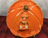 PUMPKIN PLATE Wheel thrown, hand altered and sculpted ceramic plate or wall hanging. A friendly face to enjoy for the holiday season. PPL6