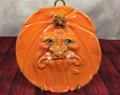 PUMPKIN PLATE Wheel thrown, hand altered and sculpted ceramic plate or wall hanging. A friendly face to enjoy for the holiday season. PPL10