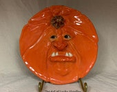 PUMPKIN PLATE Wheel thrown, hand altered and sculpted ceramic plate or wall hanging. Just a friendly face to enjoy for the holiday season.