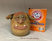 SMELLY EATER  - wheel thrown, hand altered and sculpted. What a cute face to take away those smelly things in your refrigerator.