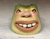 CREAMER - wheel thrown, hand altered and sculpted.  Just a friendly face to enjoy with your coffee creamer.