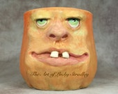 CERAMIC PUMPKIN MUG, wheel thrown, hand altered and sculpted. Just a friendly face to enjoy your morning beverage with.