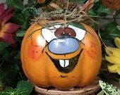 PAINTED FANCY PUMPKIN - Painted and decorated hard foam pumpkin. Just a friendly face to brighten your day for Halloween and Thanksgiving.