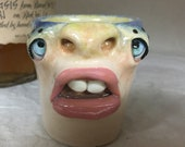 SHOT GLASS - wheel thrown, hand altered and sculpted. A friendly face to enjoy your favorite beverage. Holds 3 oz of your favorite beverage.