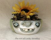 SMALL CERAMIC BOWL -Wheel thrown, hand altered & sculpted. Just a friendly face to hold small items, candles, Q Tip or favorite candy.