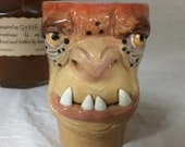 SHOT GLASS - wheel thrown, hand altered and sculpted. A friendly face to enjoy your favorite beverage. Holds 5 oz of your favorite beverage.