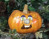 PAINTED PUMPKIN - Painted and decorated hard foam pumpkin. Just a friendly face to brighten your day for Halloween and Thanksgiving.