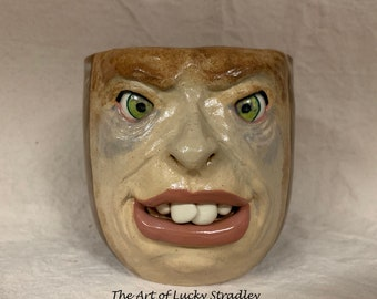 Mug - 21 - 25 ounces, wheel thrown, hand altered and sculpted. Just a friendly face to enjoy your morning beverage with.
