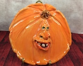 PUMPKIN PLATE Wheel thrown, hand altered and sculpted ceramic plate or wall hanging. A friendly face to enjoy for the holiday season. PP2