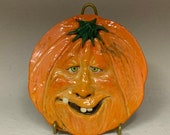 PUMPKIN PLATE Wheel thrown, hand altered and sculpted ceramic plate or wall hanging. A friendly face to enjoy for the holiday season.
