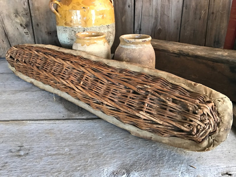 Rustic long vintage French baguette bread proofing basket from France. French Country Basket Inspiration: Resources for Rustic, French Market, and Boulangerie as well as photos to Inspire!