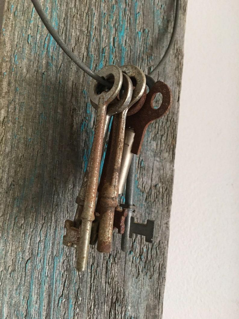 old piece of board vintage skeleton keys on rustic board and hook vintage keys free shipping vintage hook