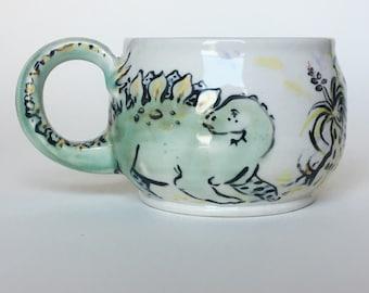 Large Hand Painted Stegosaurus Dinosaur Tail and Butterflies Mug | Emerald Green and Buttercup Yellow Porcelain Tea Mug