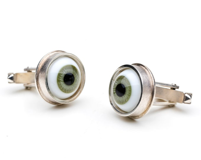 Cufflinks, 925/000 silver. Doll's eyes, green.