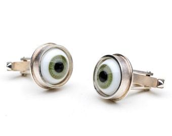 Cufflinks, 925/000 silver. Doll's eyes, green.