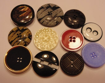 11 piece large odd acrylic button mix, 26-34 mm (12)
