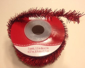 5 yards of red tinsel garland, (LR10)