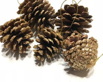 5 with gold glitter edge pine cone ornaments, on avarage 2 - 2 1/2 inch