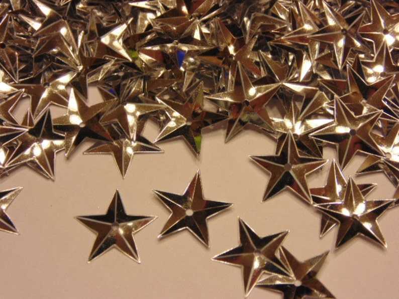 40 count bag of silver color star sequins 15 mm 1 image 0