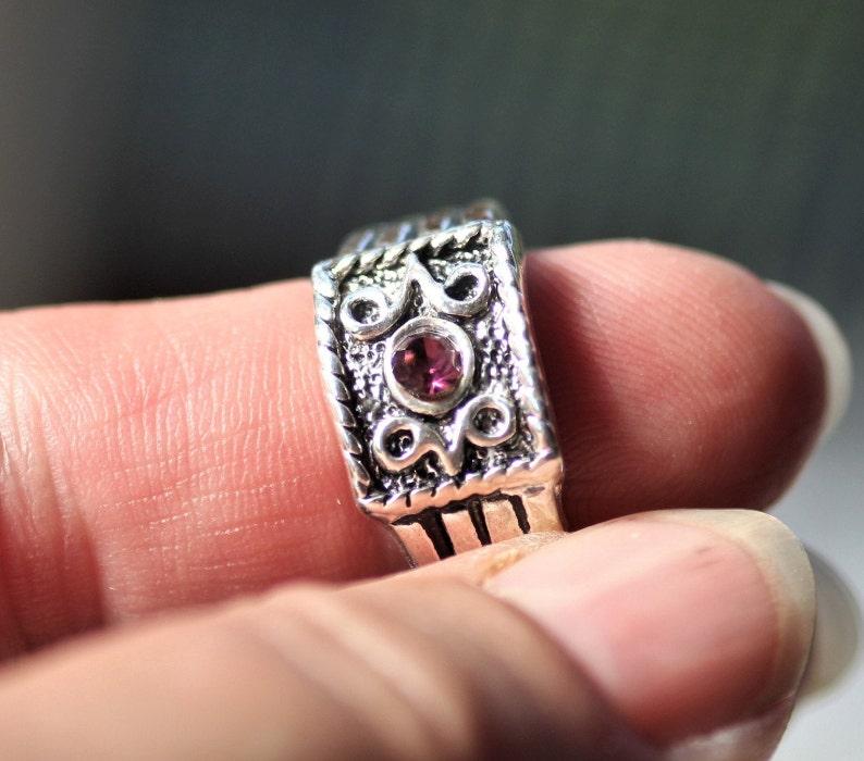 Silver Tone Costume Jewelry Ring with Purple Rhinestone