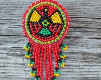 first Nation badge wheel holder native American beadwork eagle badge wheel holder