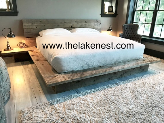 Reclaimed wood platform bed base with nighstands and elongated angled solid wood headboard back rest