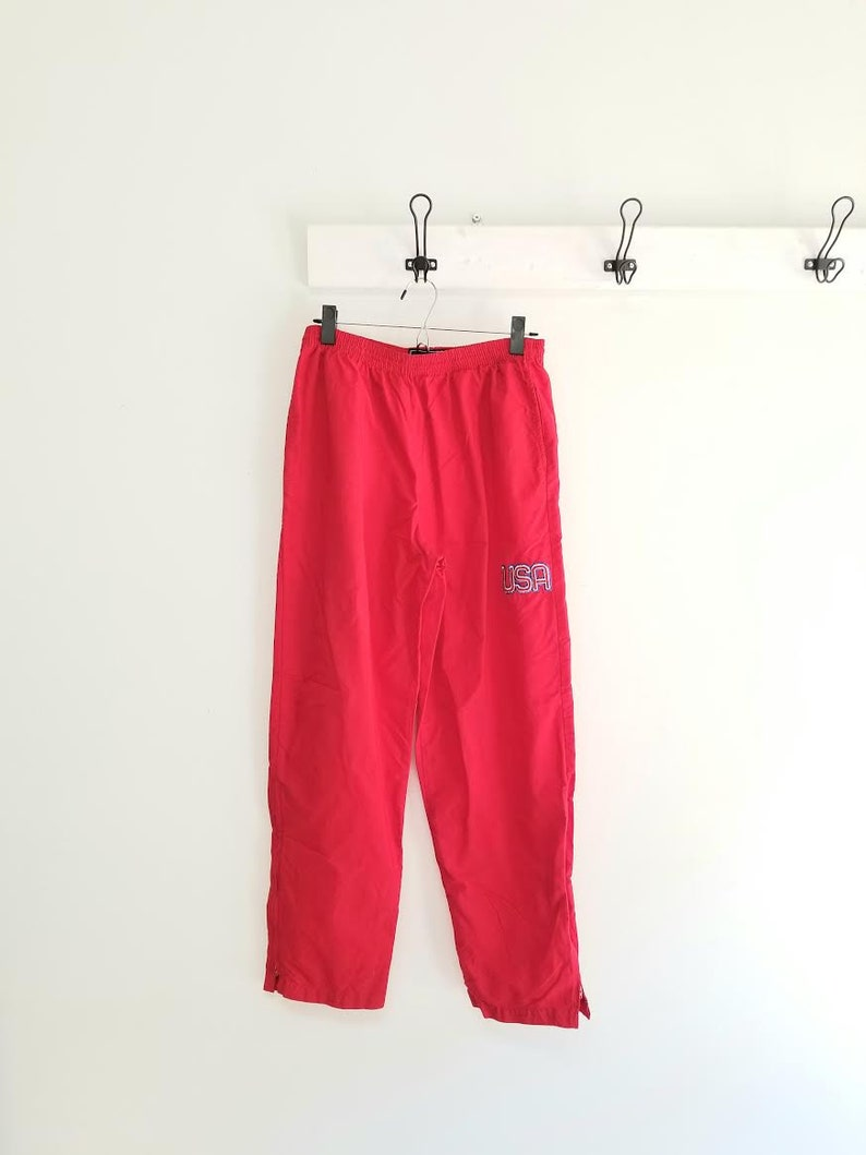 USA windbreaker pants 90s high waist athletic pants with zip up ankles size medium