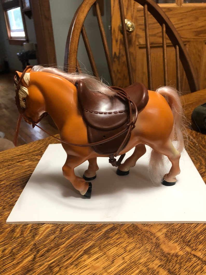 Never played with bought it for my collection-fits strung Ginny but not walker Ginnys Horse for Ginny 1980s I cant remenber who made it