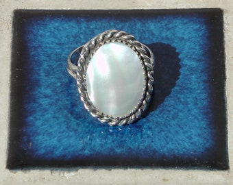 mid 1970's silver ring with unknown stone, perhaps mother of peral, size 9