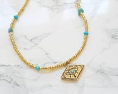 Gold beaded evil eye protector choker necklace with sleeping beauty turquoise centre stone,  turquoise and gold eye of Ra fashion necklace