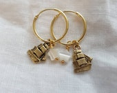 Charm drop hoop earrings with mother of pearl star bead and golden brass hand carved ship charm. Homeward bound ship & north star hoops