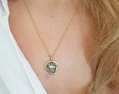 Lion head medallion penda...