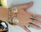 Four coin statment bracel...
