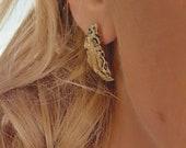 Broken coin stud earrings...