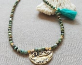 Turquoise blue green beaded bohemian choker necklace with rustic coin pendant in golden brass with tassel detail, beaded layering necklace