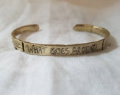 Gold banner adjustable cuff bracelet; What goes around... message vintage style scroll design