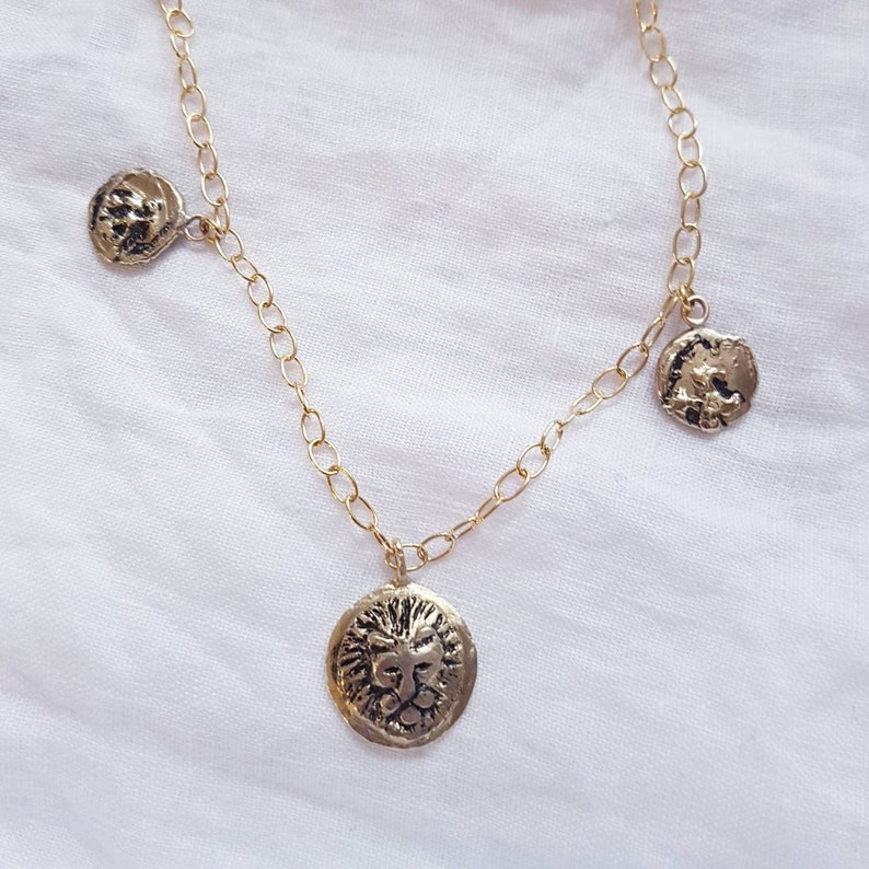 Triple coin choker necklaceGolden lion head medalion and coin image 0