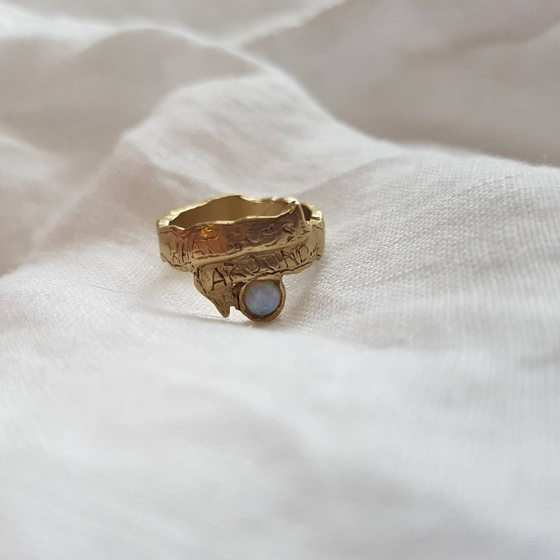 Opal cabochon golden scroll band solitaire ring  what goes image 0