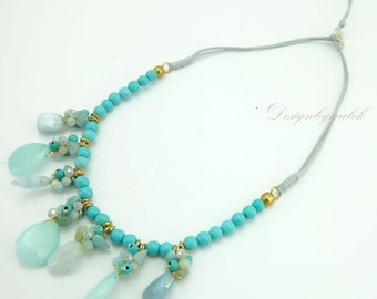 Light blue turquoise,crystal on cotton thread necklace.