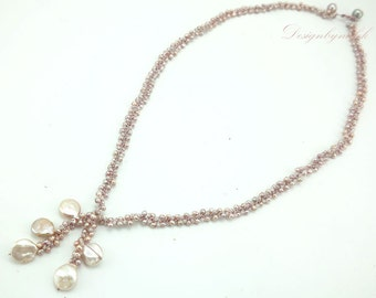 Light pink freshwater pearl on silk long necklace.