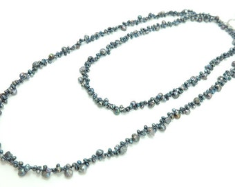 Dark grey freshwater pearl long necklace.
