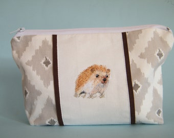 Grey and white cotton zipper bag with hand embroidered hedgehog