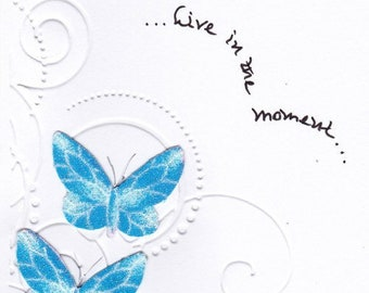 Handmade greeting card created with fabric  dimensional butterflies on an embossed background