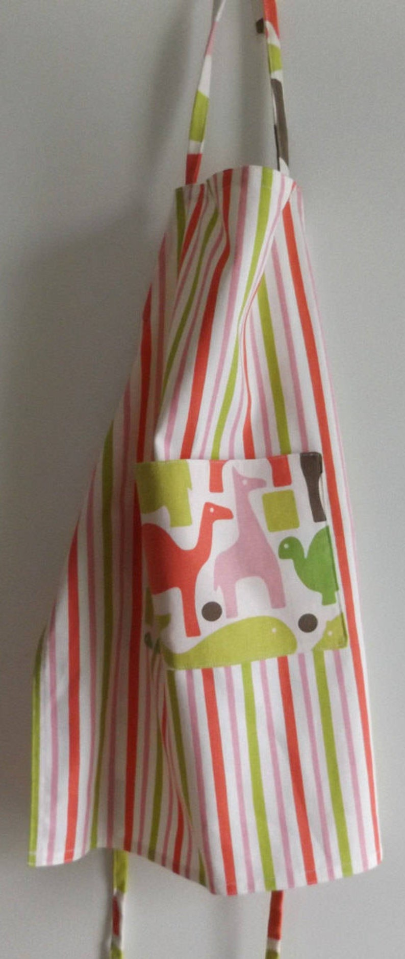 Child/'s Striped Top-Stitched Apron with Lined Pocket of Pinks Yellow /& Green Fabric by Dwell Studio Turtles and Rhinos Christmas Gift