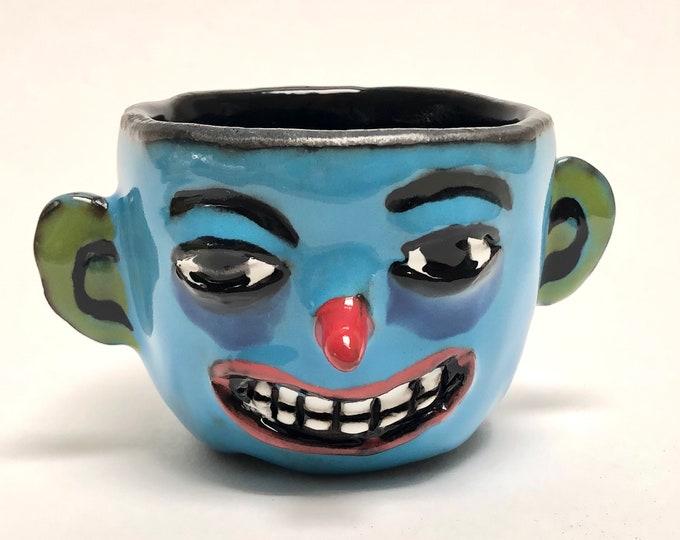 Porcelain happy face cup.