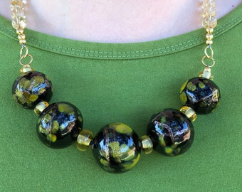 Pretty necklace of black blown hollow handmade lampwork glass beads, 21 inches