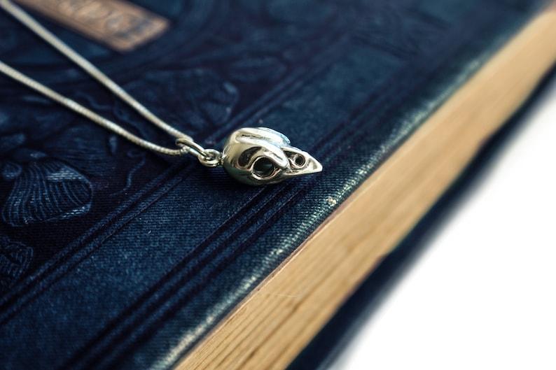 Sterling Silver Tiny Bird Skull Charm Necklace . Skull image 0