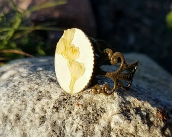 Pressed Flower Jewelry Greenery in Resin on a Brass Colored Setting Ring